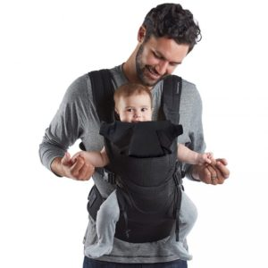 Dad carrying son in Contours Love Carrier