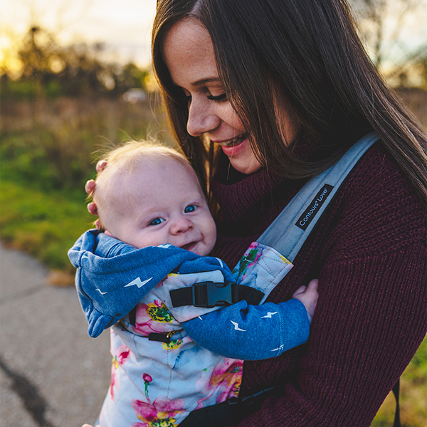 Mother smiling at baby in Contours Love Carrier