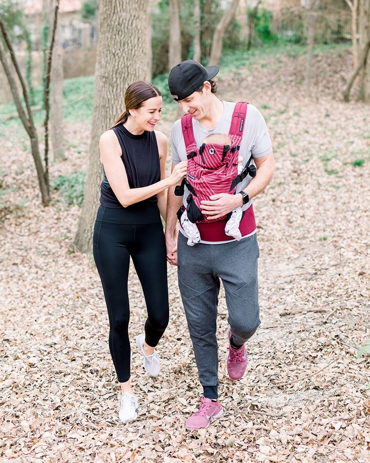 Couple hiking with baby in Contours Journey Carrier