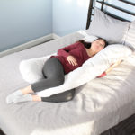 Mom-to-be sleeping with the Contours pregnancy pillow