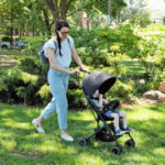 Mom strolling with child in the Itsy stroller